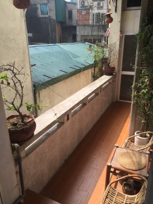 Balcony connecting living room and bedroom